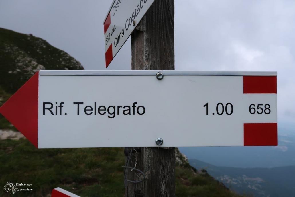 Der Wegweiser zum Rifugio Telegrafo zeigt uns die Entfernung an.